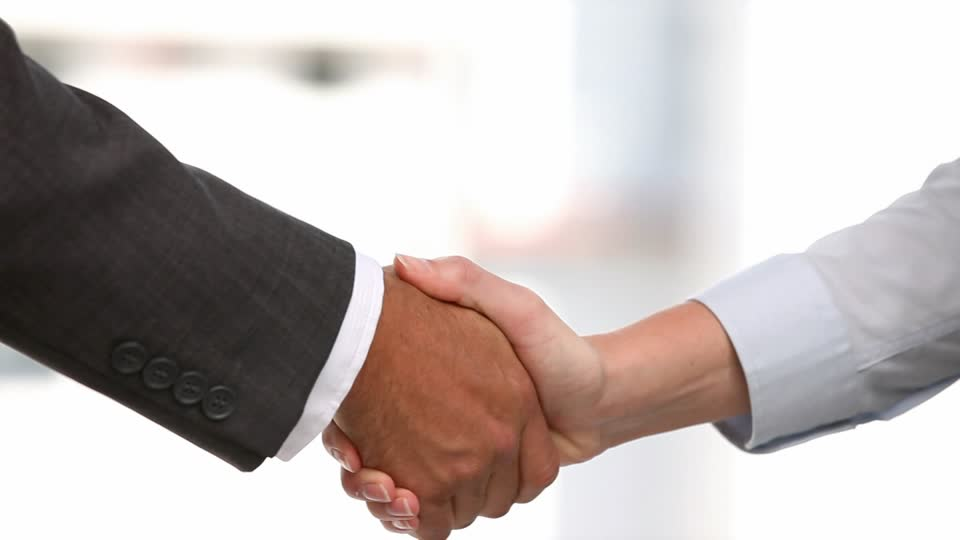 702959352-sleeve-agreement-congratulating-handshake